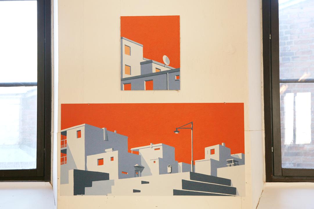 Två färgstarka akrylmålningar av Gustaf Lord på väggen i ett galleri